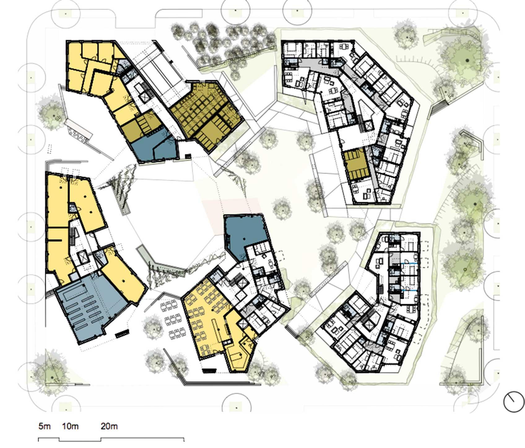 Plan över WagnisART, München, ett kvarter format tillsammans med de blivande  boende. Vitt= bostäder, blått=gemensamt, gult= lokaler.