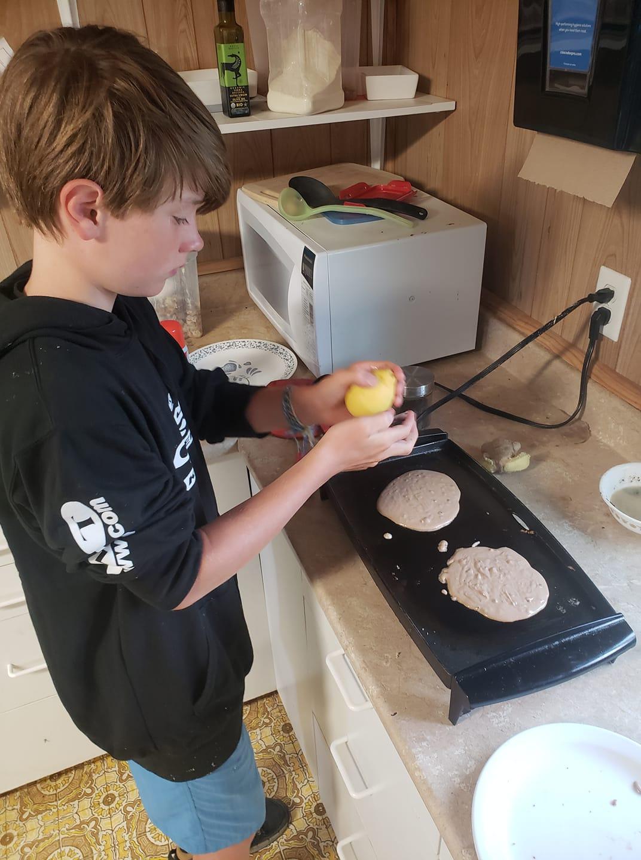 Chef West Burge making fancy pancakes.