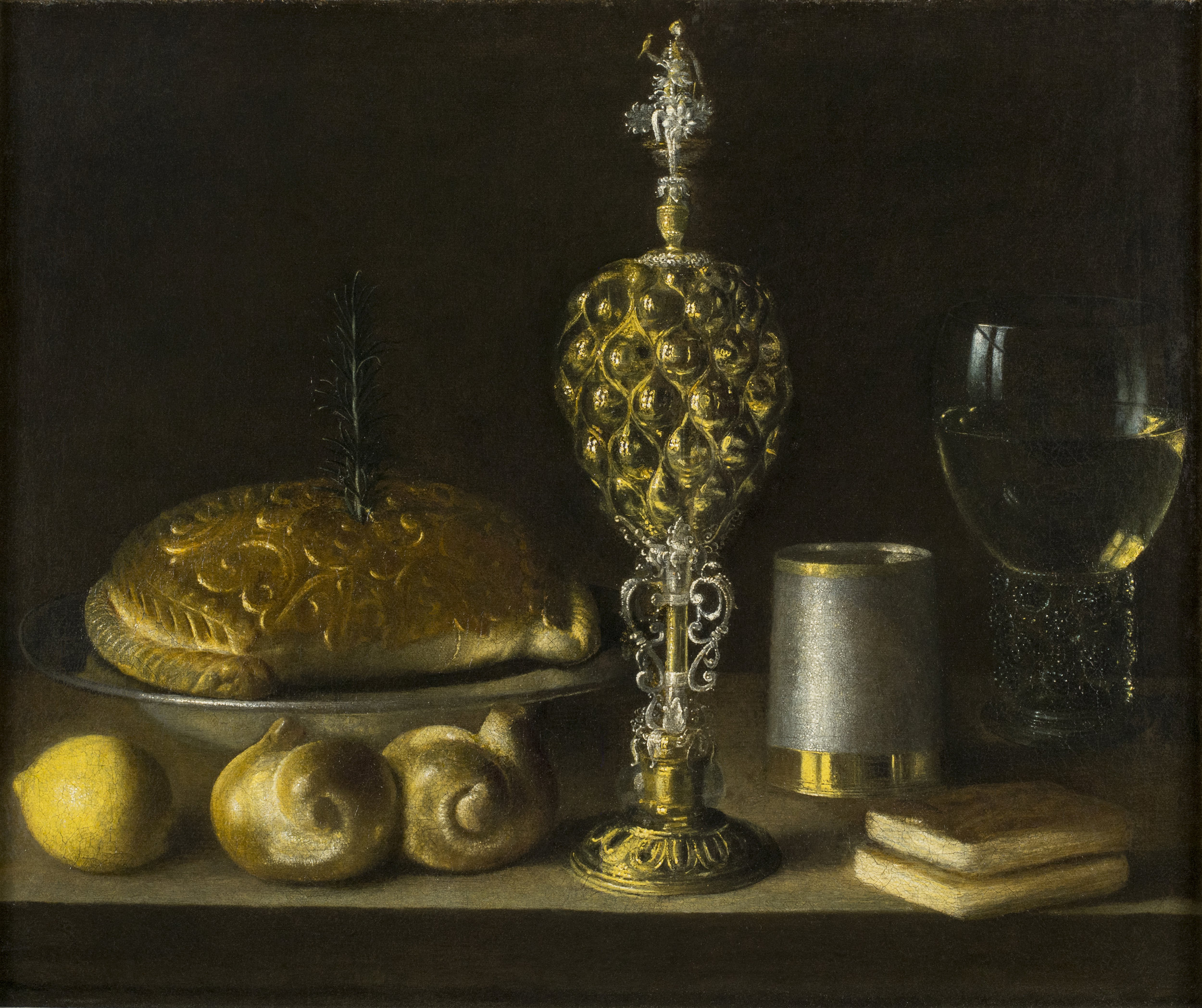 Sebastian Stoskopff  (b. 1597)  A Still-Life of Drinking Vessels, a Pineapple Cup, a Lemon, Bread, and Two Small Books  19 ¼ x 23 ⅜ in. oil on canvas