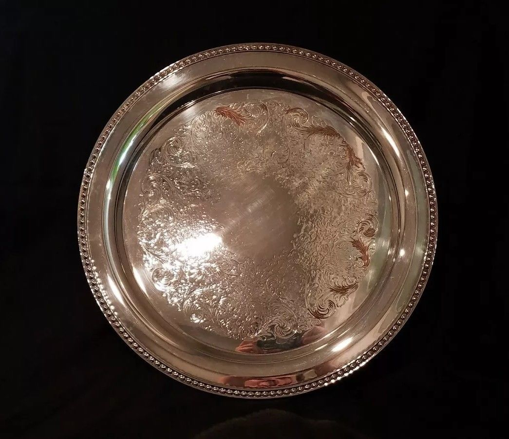 "Vintage W M. Rogers Silverplate Round Tray 15""    $45.00"