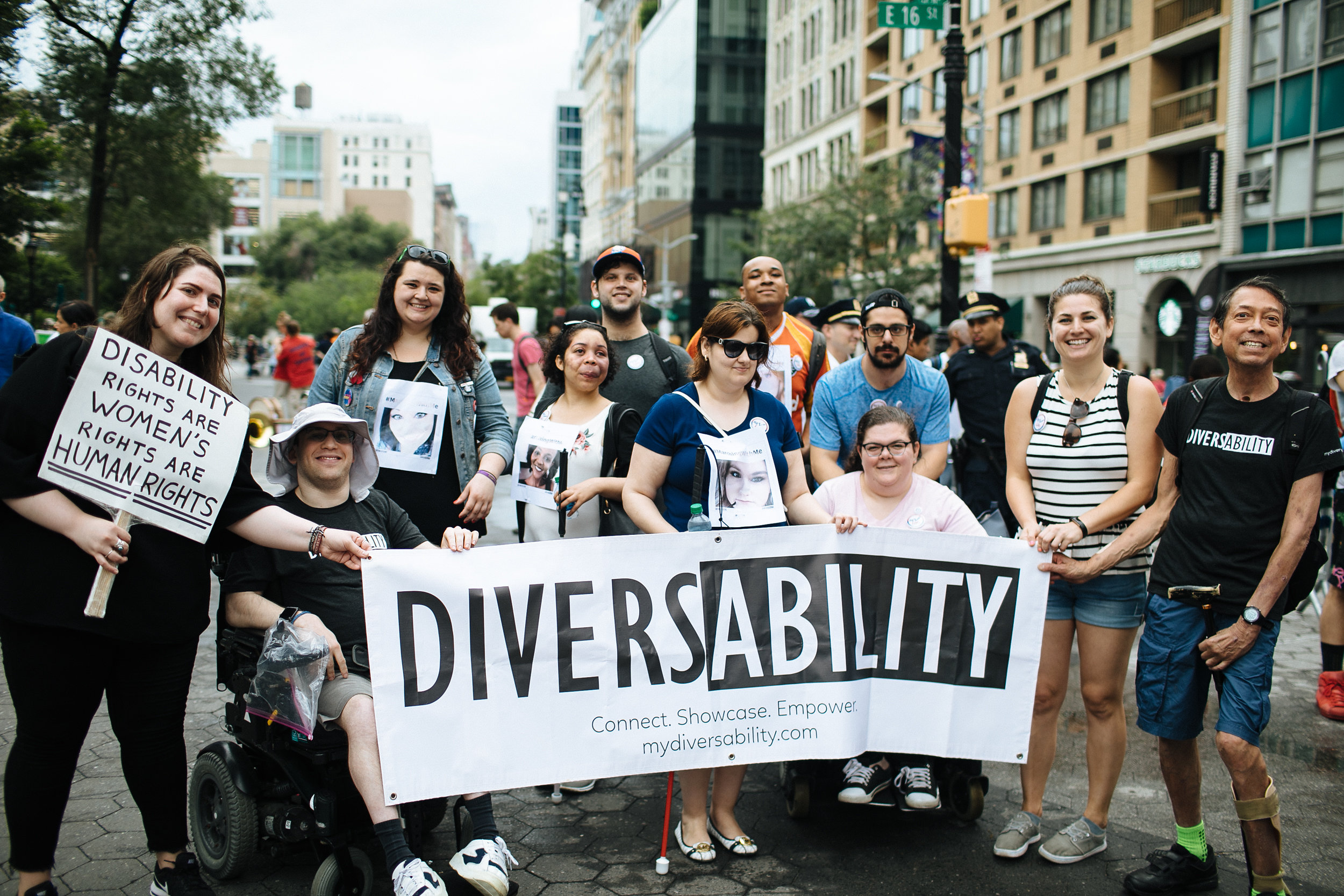 Diversability community members pose for a picture at the parade.