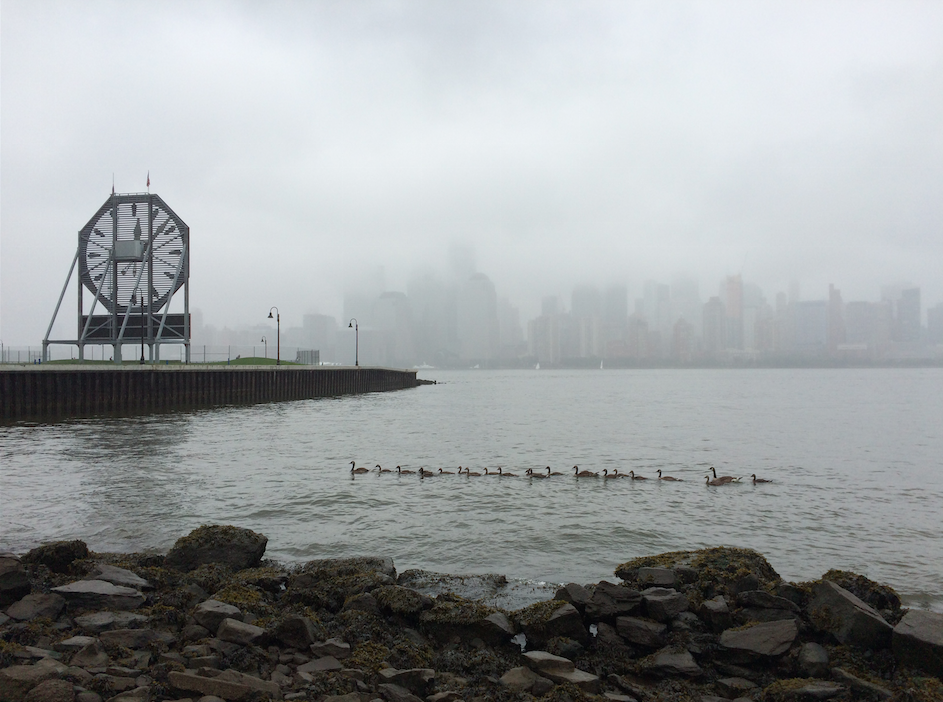 View of downtown Manhattan and Jersey City's Colgate clock in the fog.