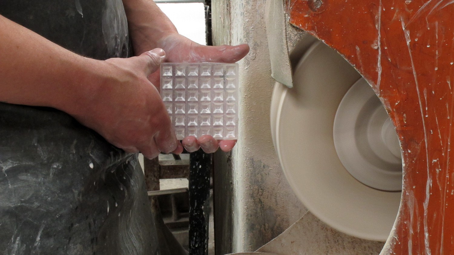 Hand finishing a crystal tile