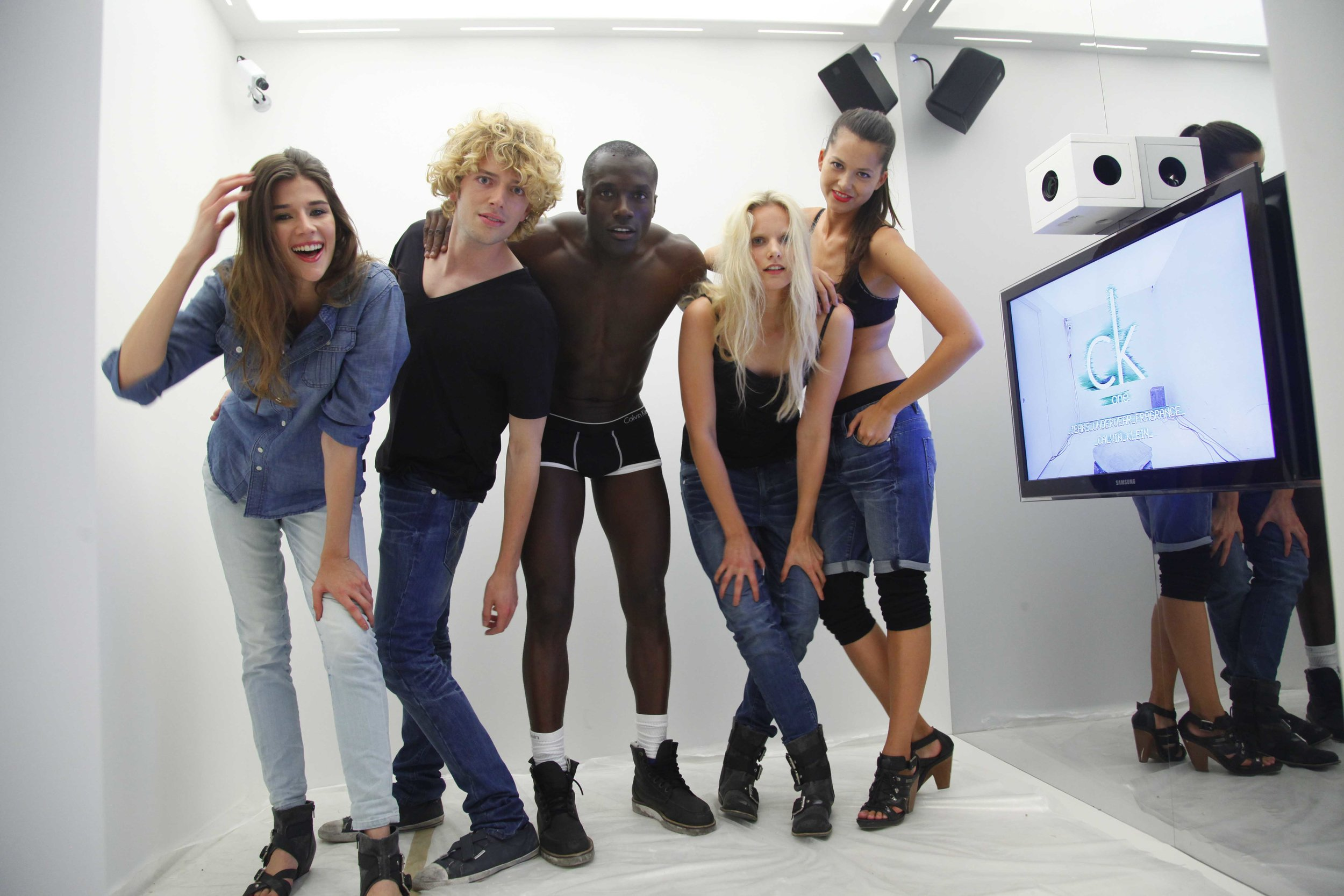 """Local models dressed in CK One,enticed partygoers to participate in the video """"Get in the Box""""activation."""