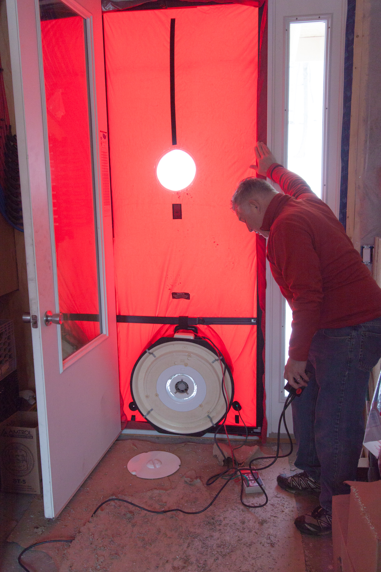 T.J. Holloway from Efficiency Vermont, performing the blower door test.