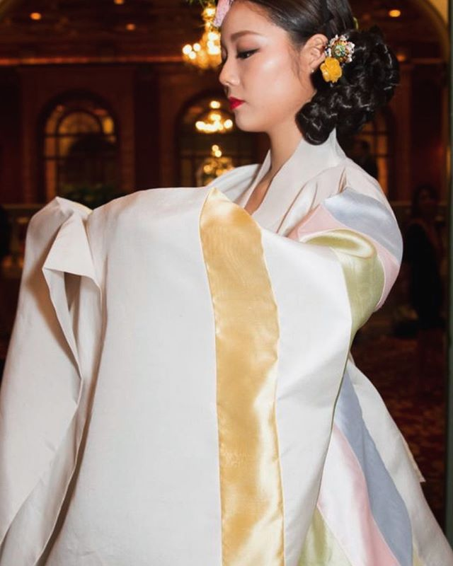 "The ""Wonsam"" robe was historically worn by the by queens, high ranking court ladies, and royalty during the Joseon dynasty of Korea. We created this one with soft pastel accents as a bridal piece. 👰🏻 Would you wear this on your wedding day? 🥰✨ #LEEHWA #LEEHWAwedding #weddingwear #bridalhanbok"