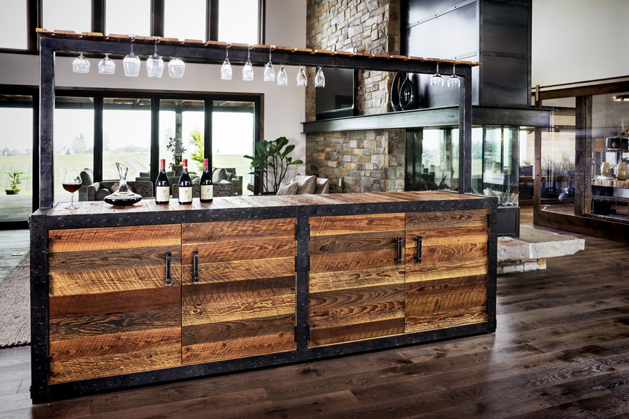 This custom wine bar and cellar was crafted from wood we hand harvested from a 100-year-old barn on our client's property.