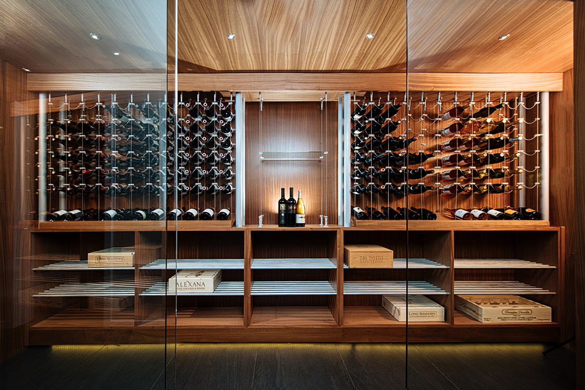 We often use glass doors to create a protected, but visually seamless entryway for a modern wine cellar.