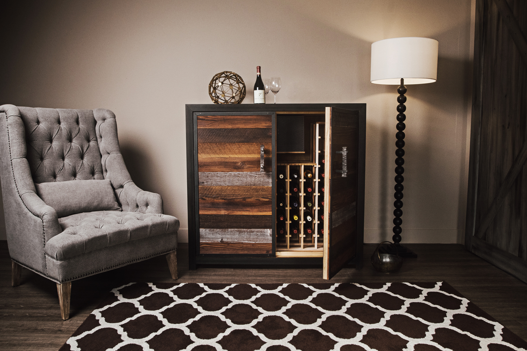 A modern side table, like our Credenza, looks great with both modern and traditionally styled furniture, like this tufted armchair. ~  Photo by Sommi Wine Cellars