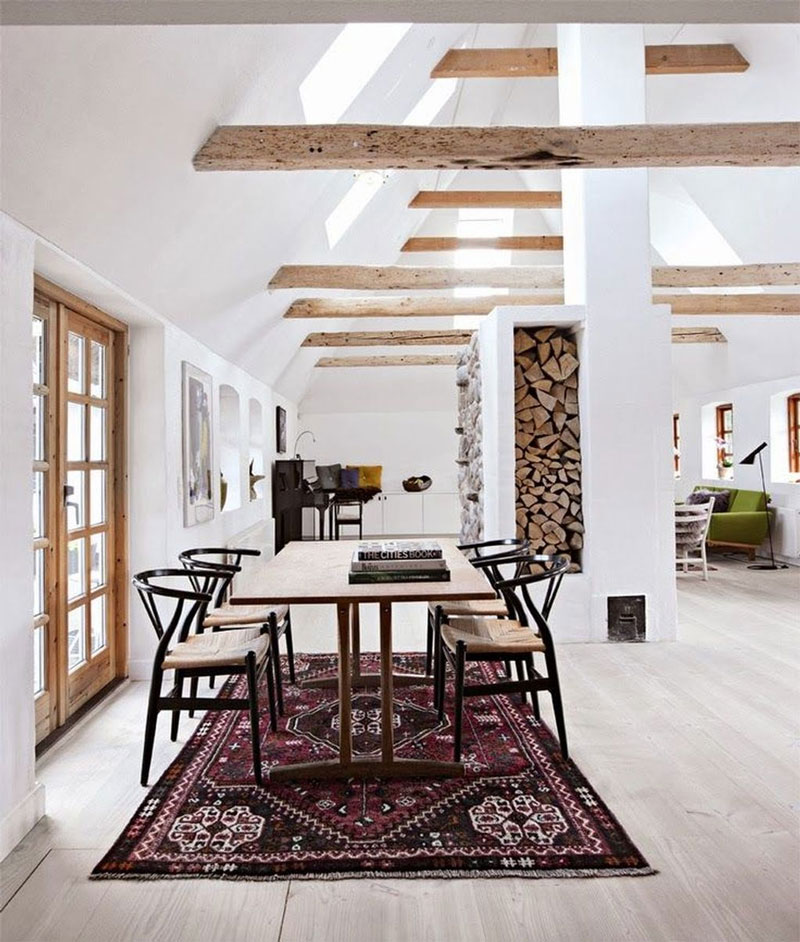 A more traditional rug choice softens up the sparse feel of this modern farmhouse.   Photo via Pinterest
