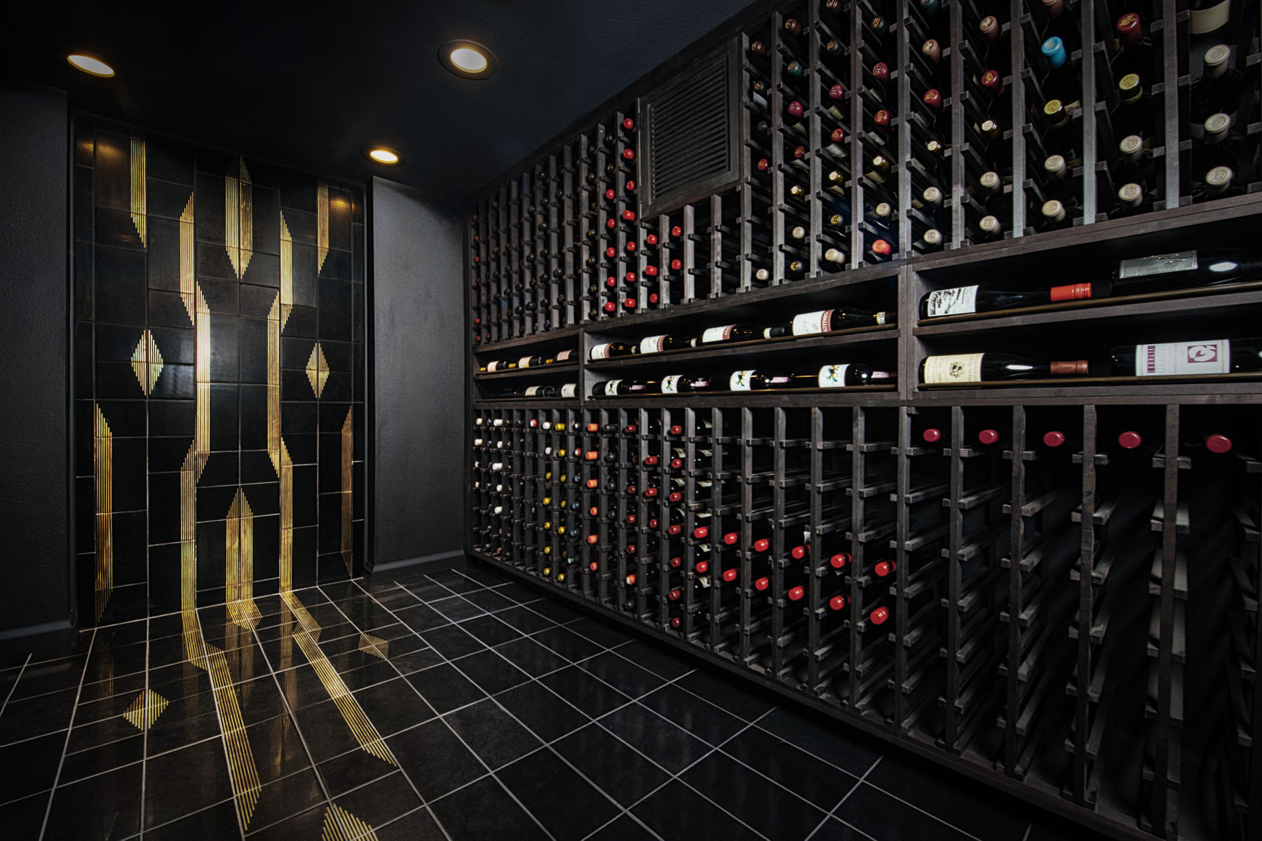 It's okay to be daring when it comes to modern wine cellar design. This Art Deco inspired tiled wall treatment makes a big statement in an otherwise sleek wine room.