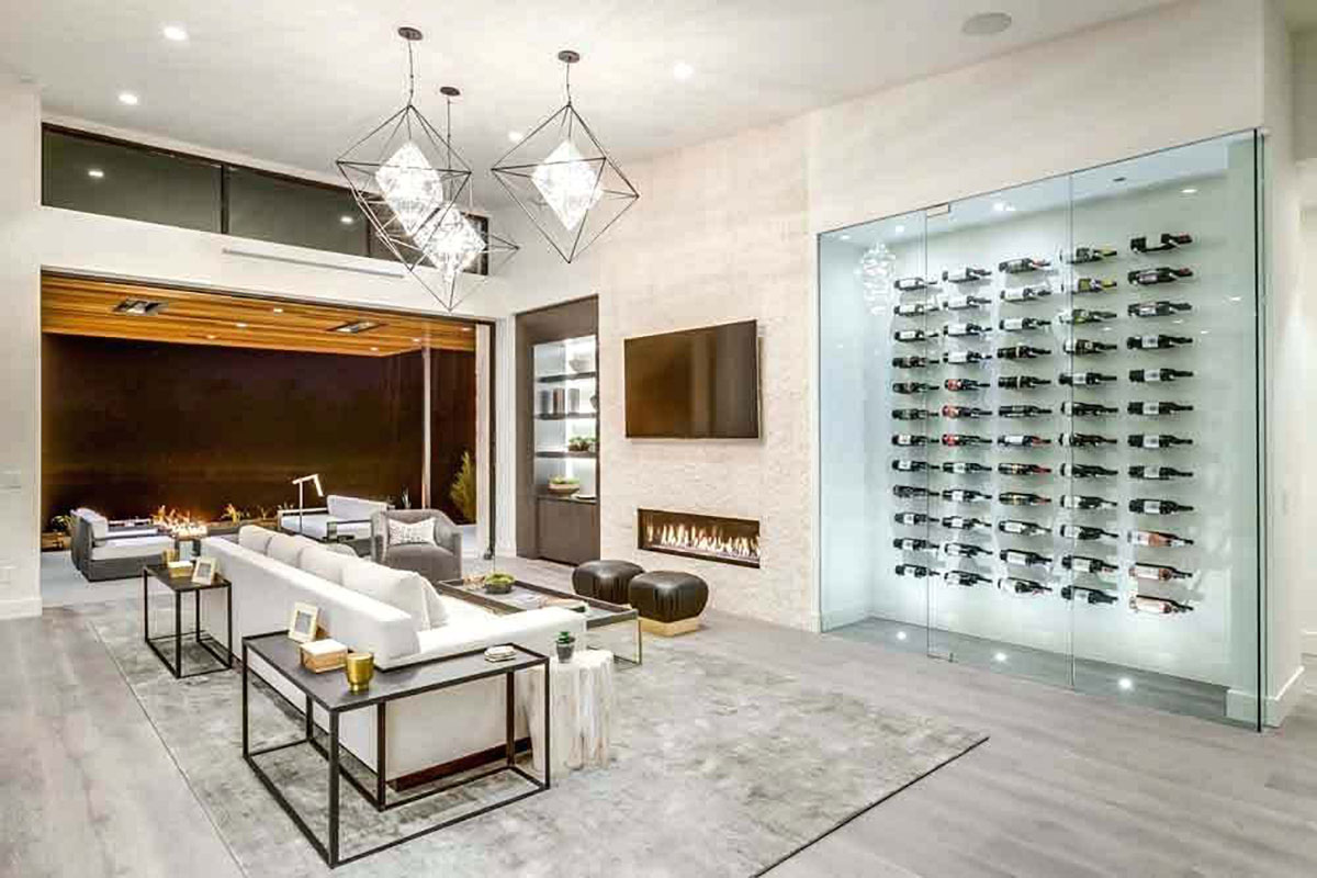 A bump out is a great way to keep an open floor plan while adding a modern wine cellar display.