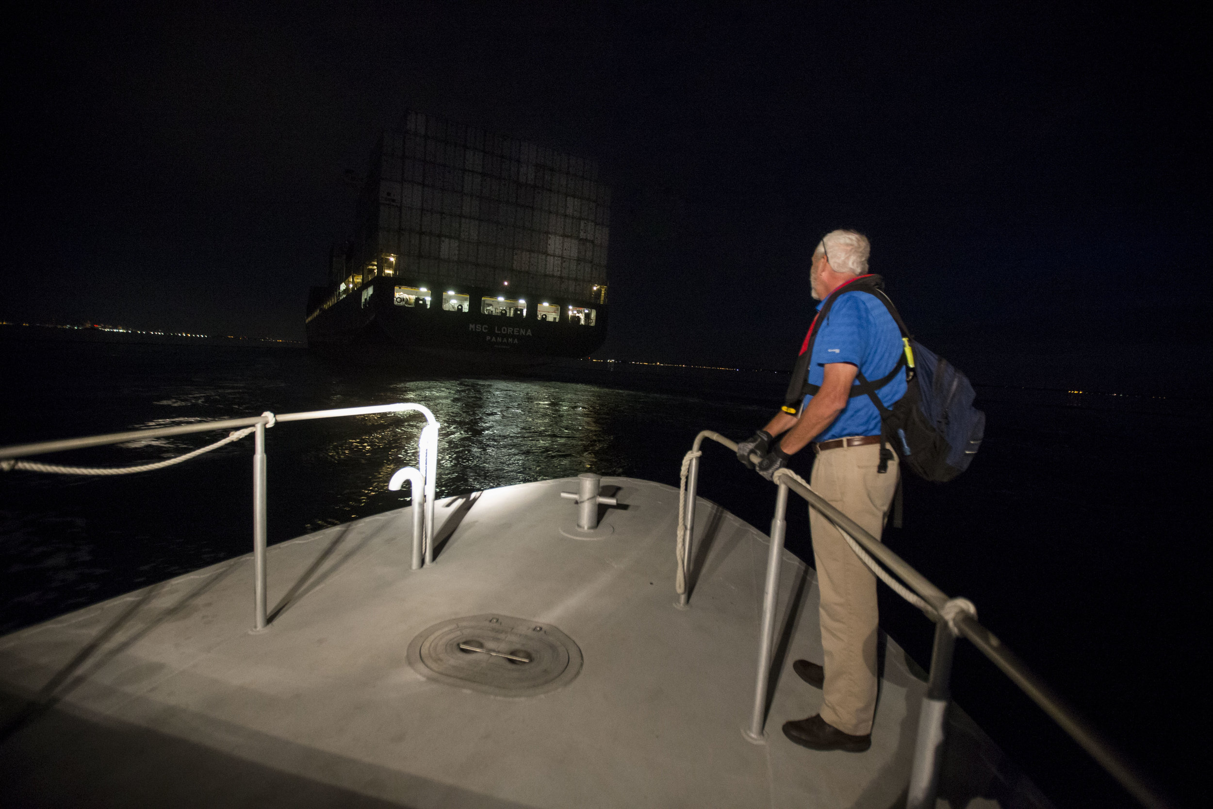 Boston Harbor Pilot looks at the cargo ship MSC Lorena as the pilot boat 'Chelsea' heads to intercept it as it heads towards Boston Harbor on Aug. 16.