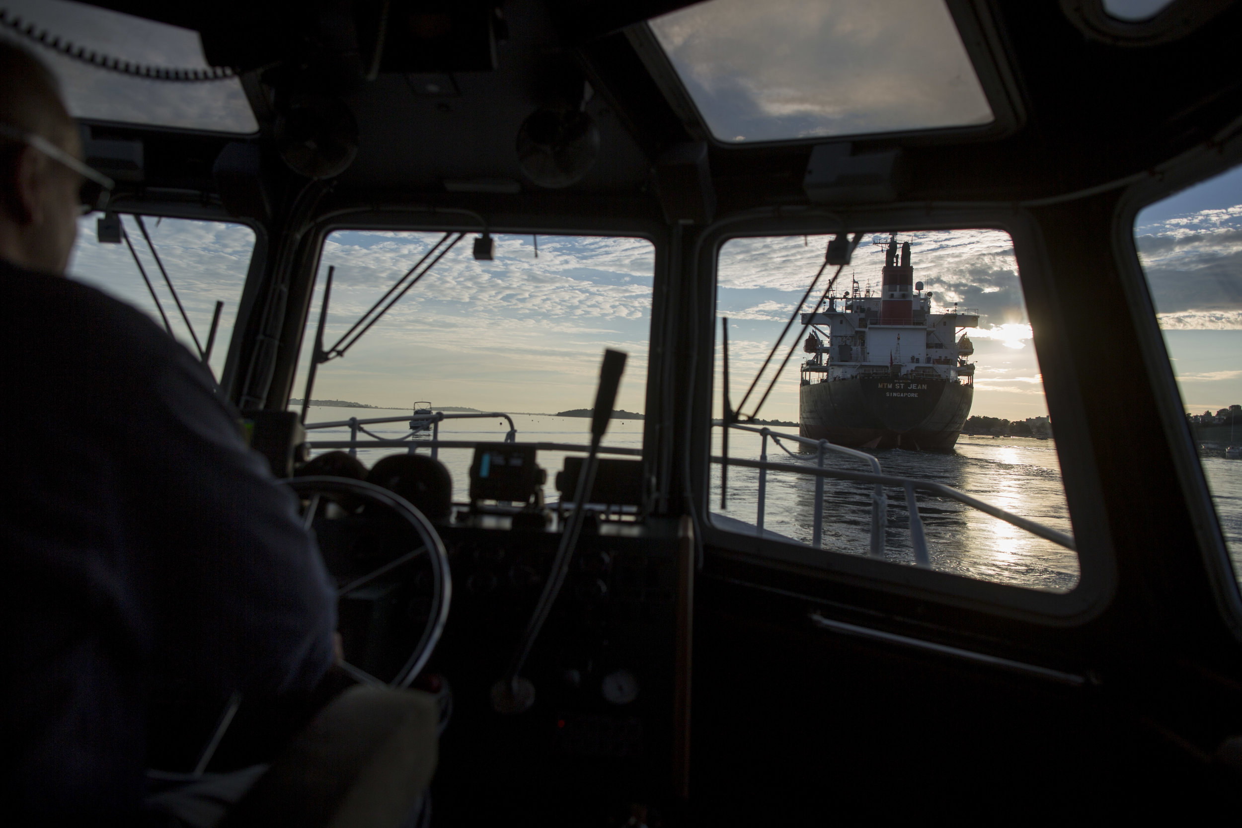 Pilot Boat Captain Joseph Maloney approaches the chemical tanker MTM St. Jean as it leaves Boston Harbor to pick up Harbor Pilot Scott MacNeil on Aug. 16.