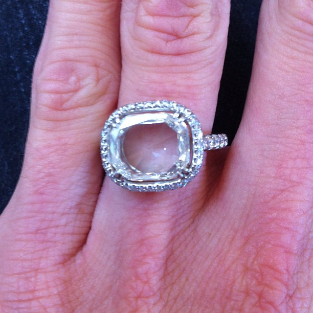 A stunningly clear and white rose cut  diamond, set upside down in a pave halo makes for Jaimie's engagement ring.