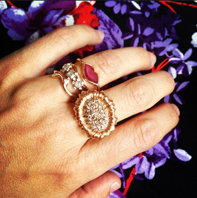Mish's sunflower ring (middle finger) pairs perfectly with her own mix-and-match bridal stack, including a Marie Helene de Taillac lips ring.