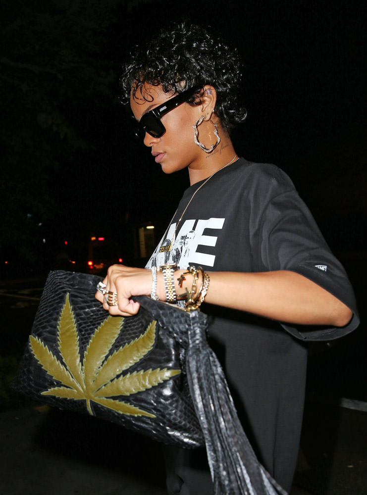 Rihanna carrying the Sweet Leaf clutch in black snakeskin with green lambskin, $2,000,  at jacquieaiche.com .