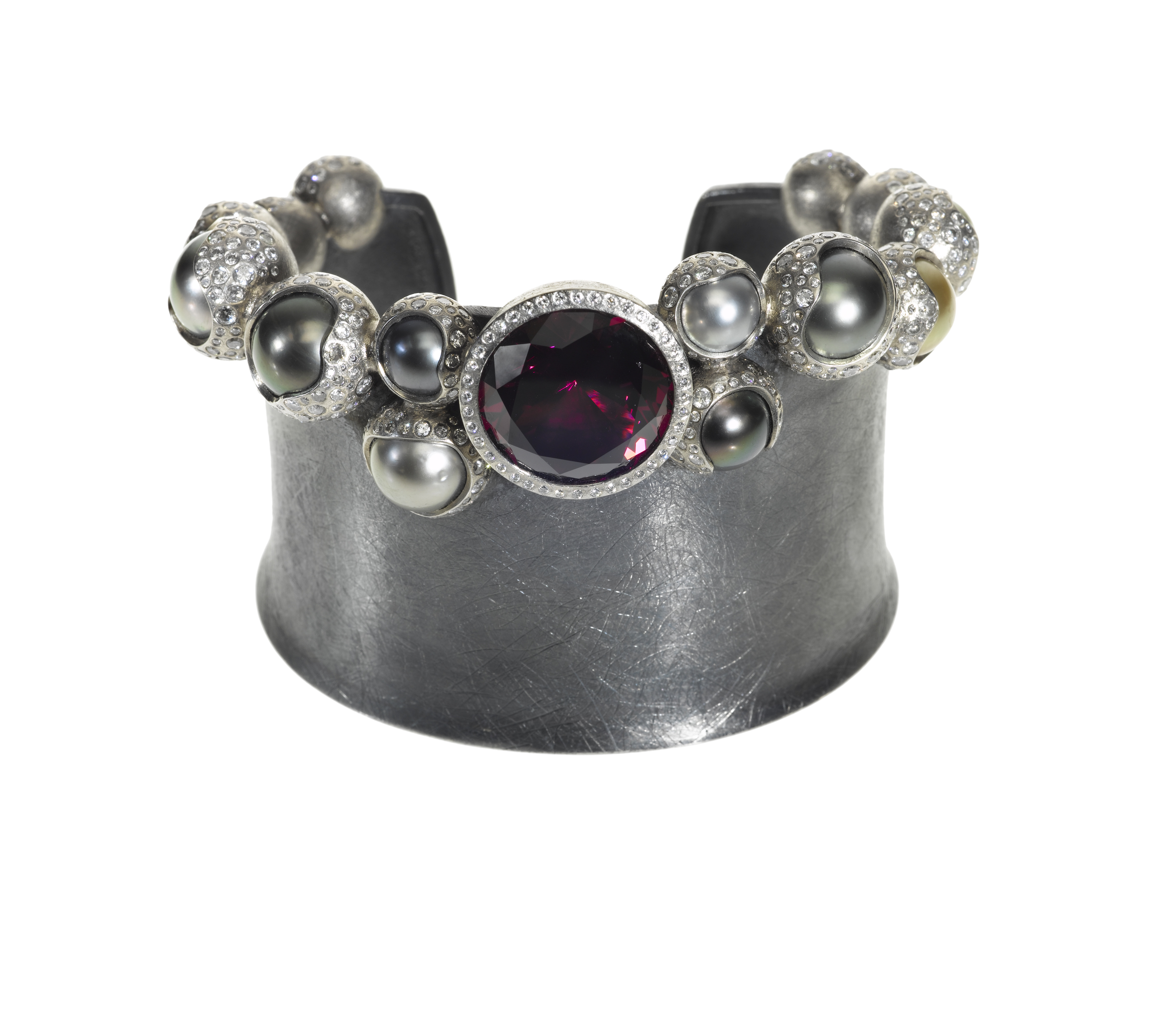 Thispearl and garnet cuffin Palladium, silver, garnet (24.97 ctw), white brilliants (9.528 ctw), and Tahitian pearls, $158,400,  available at Todd Reed .