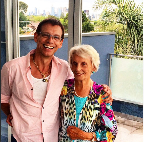 With his beloved mother at home in Australia.