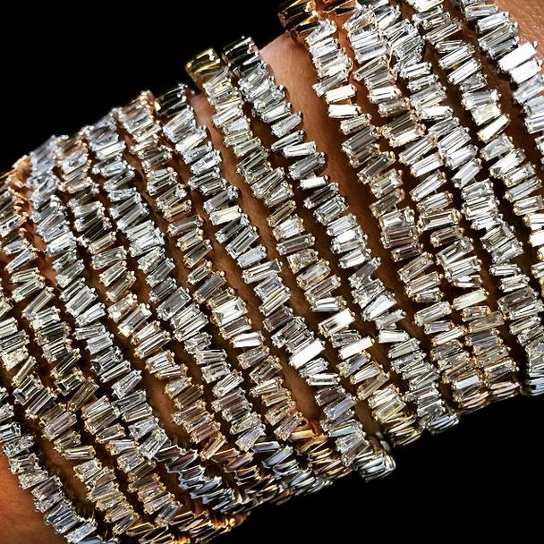 Suzanne wearing her bangles – a mix of baguette bangles and a white diamond starburst set bangle.