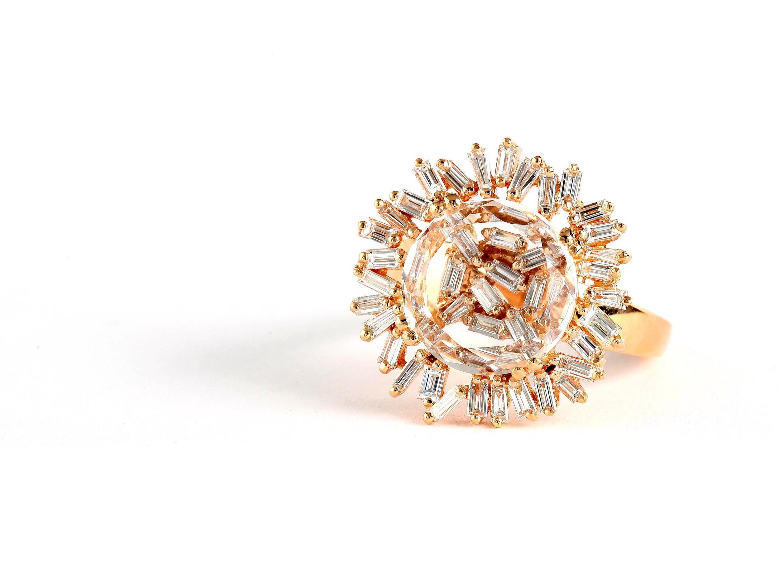 18-karat gold and diamond ring.