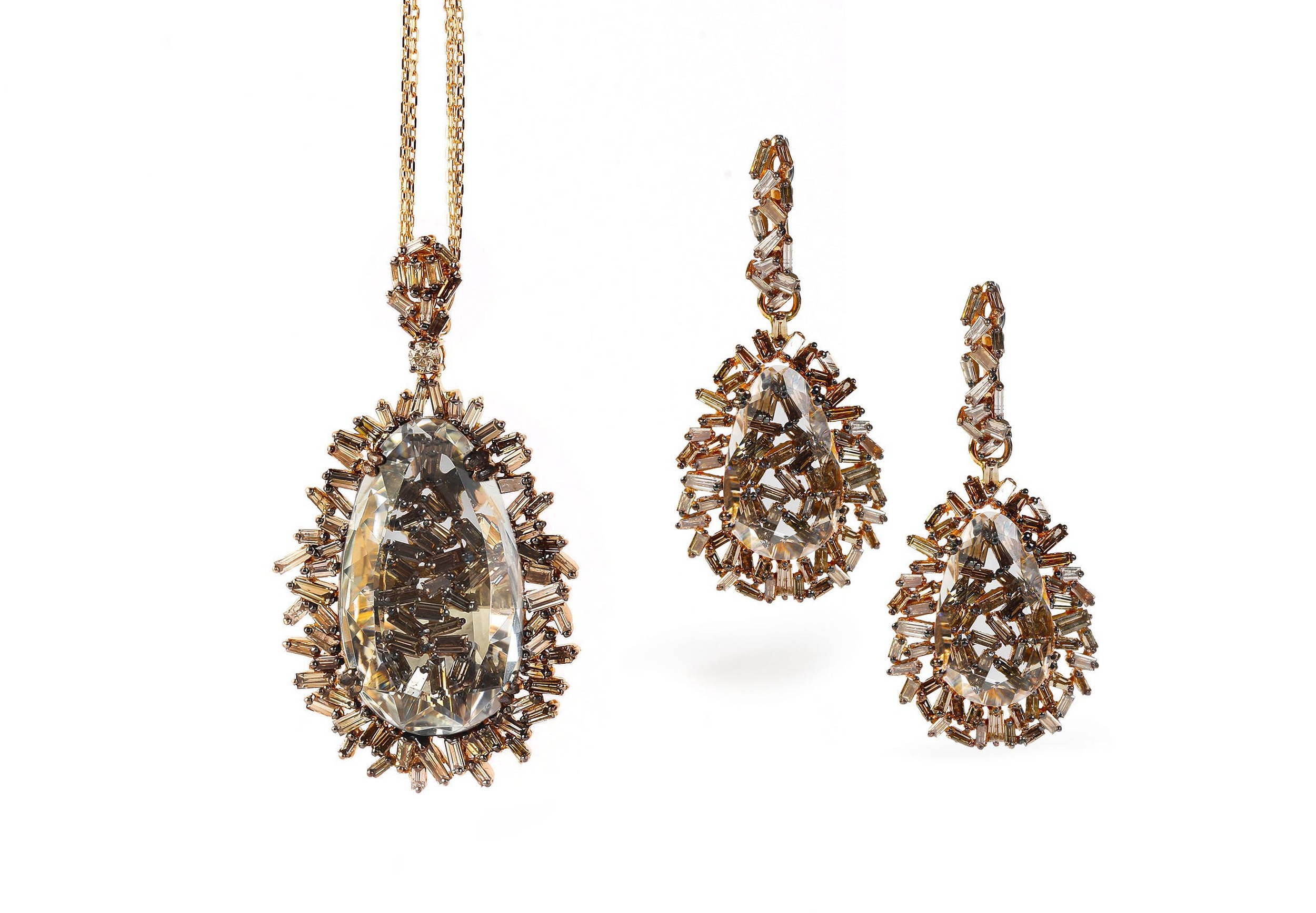 18k gold earrings and matching necklace from the Vitrine Fireworks collection.