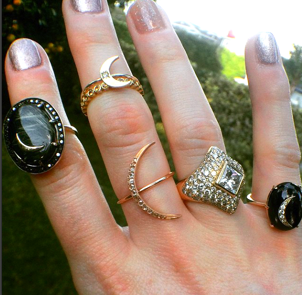 A typical stack, worn by Andrea and featuring her diamond engagement ring.