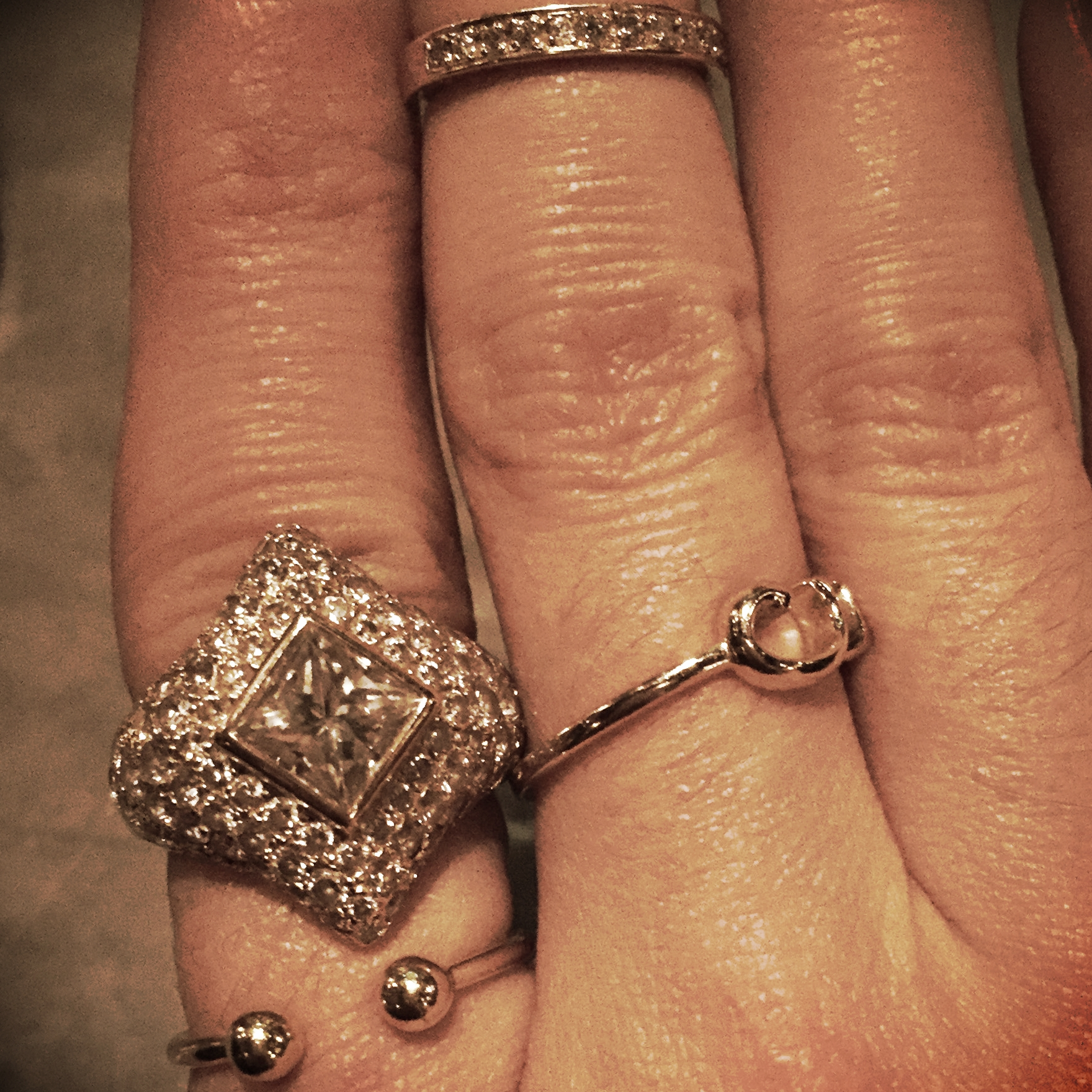 A closer look at Andrea's engagement ring and my knuckle hair.