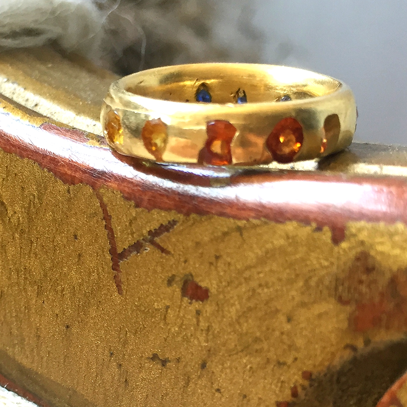 Detail shot of direct cast orange and yellow sapphires.