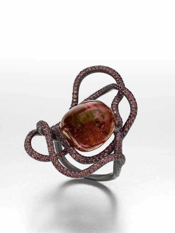 """The Lady in Red"" ring in titanium with a 35.89 carat Birman cabochon spinel and pink sapphires."