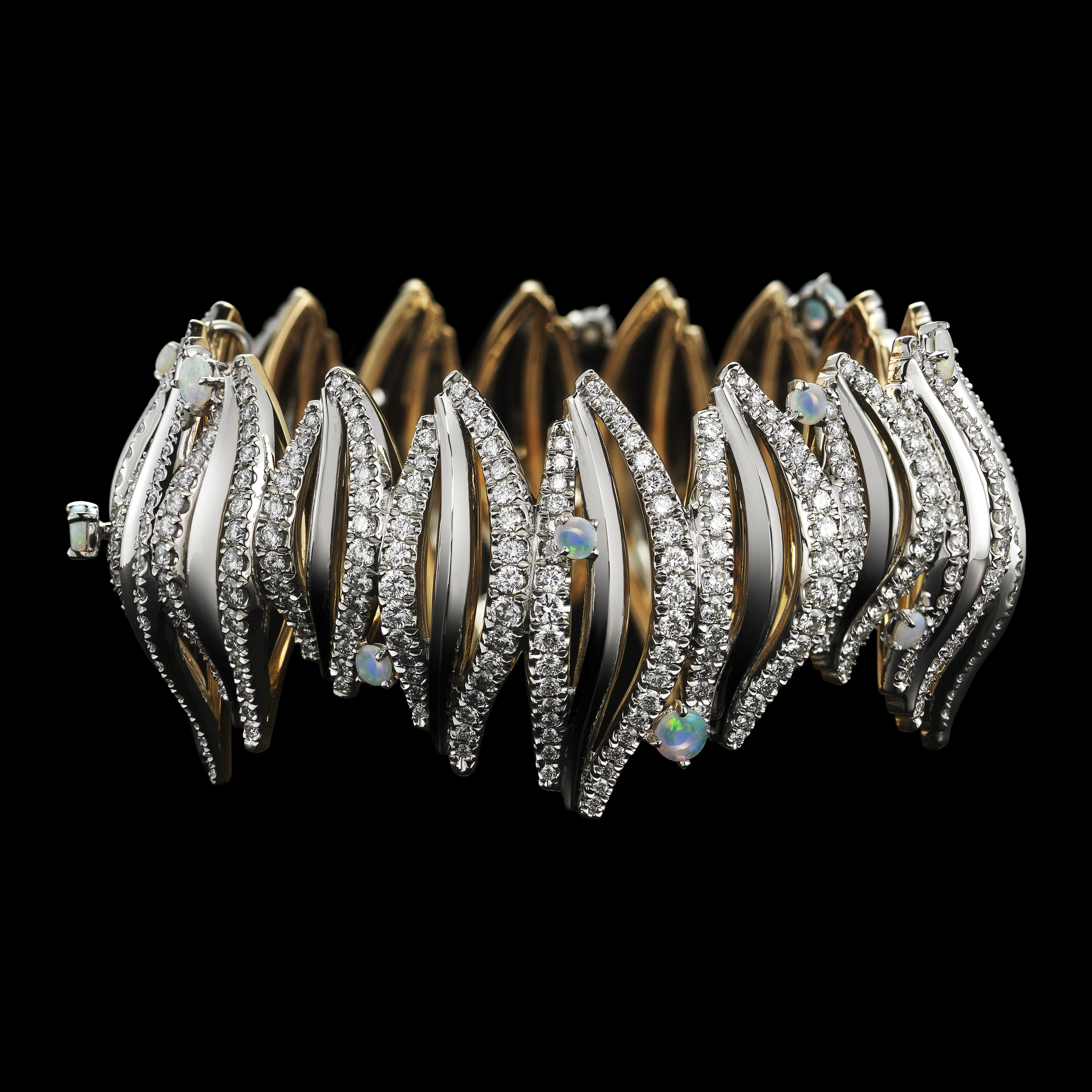 Branch diamond cuff with opal cabochons.