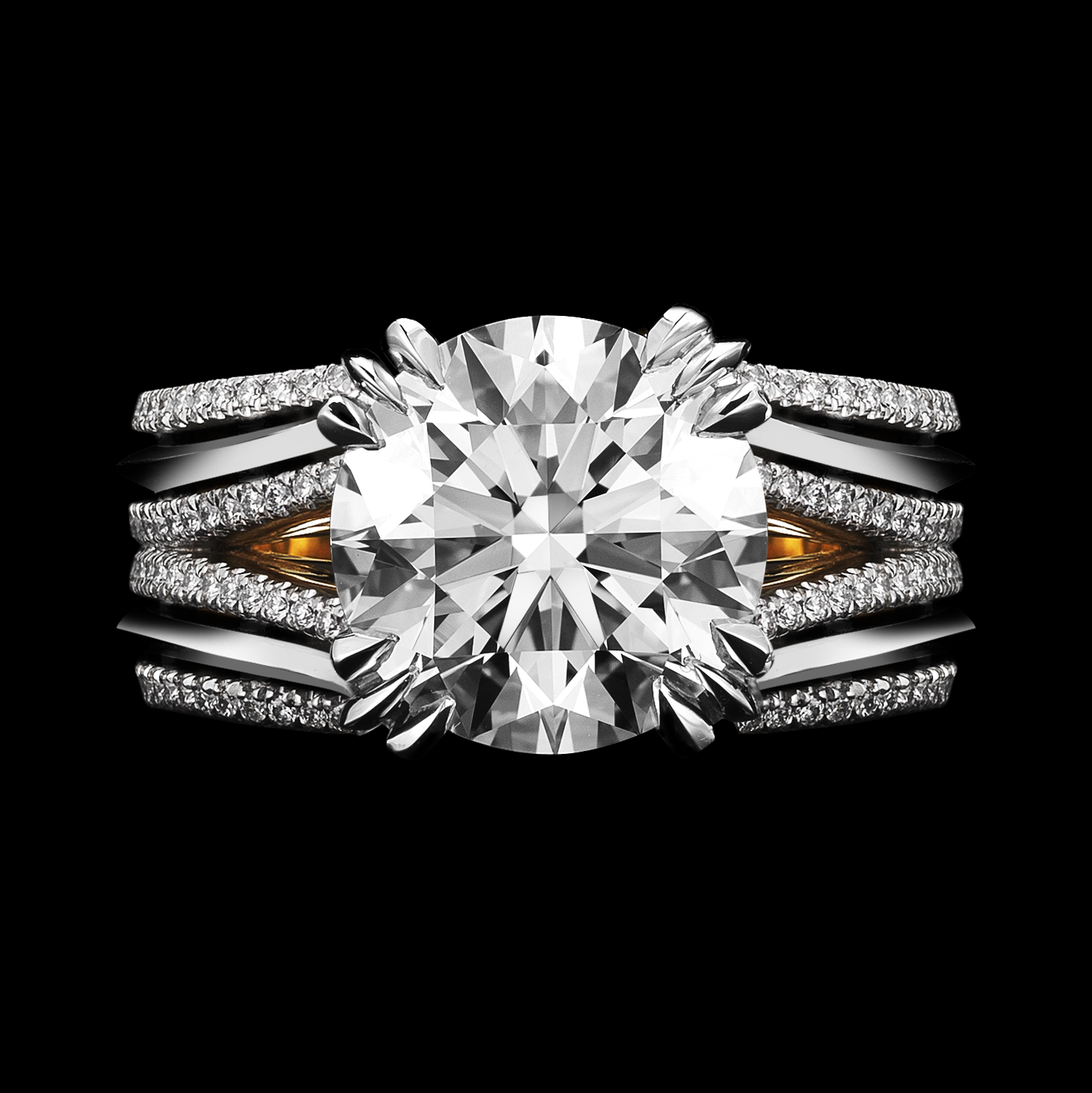 Double shank floating brilliant-cut diamond ring.
