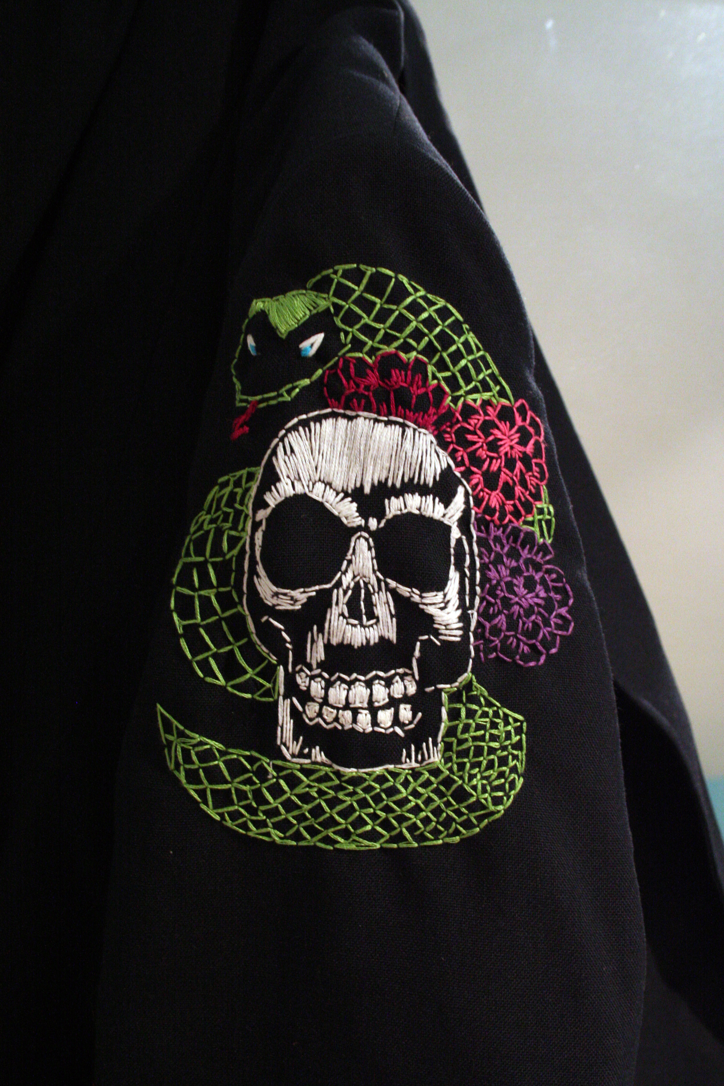 Another of her many talents – embroidery on a jacket.