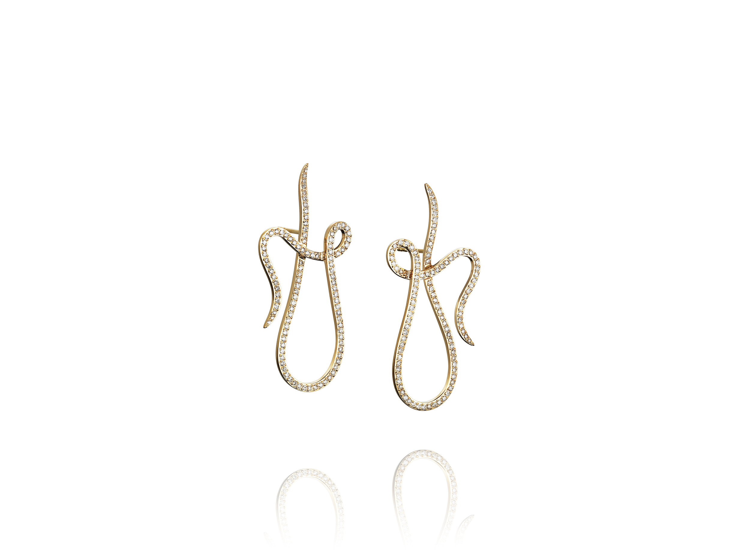 Shape of a Dream & Stars earrings in 18k yellow gold with diamonds, $6,285,  available at Efva Attling .