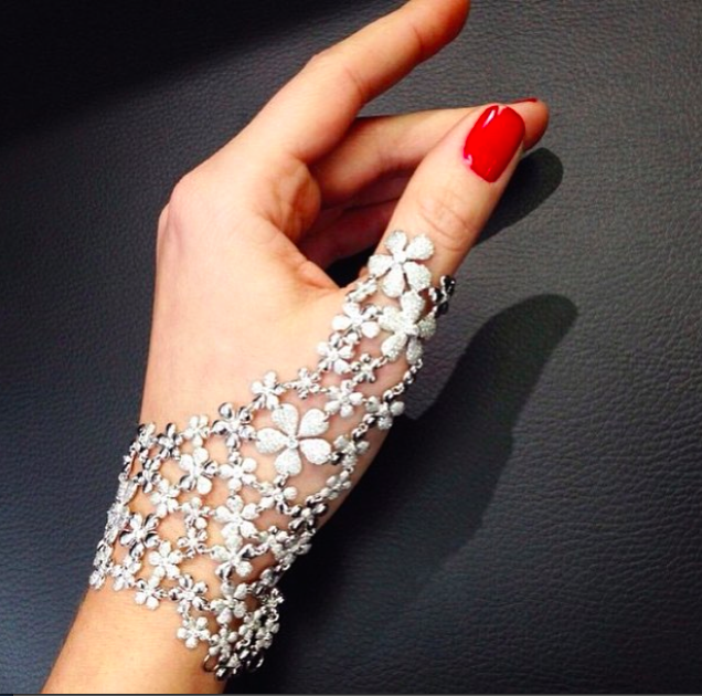The white diamond flower mitten that is currently at the top of our wishlist.