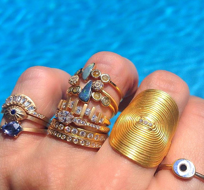 A cluster of MUSE designers, including the lust-worthy Yossi 'vinyl' ring on Jennifer's middle finger.