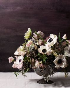 A perfect arrangement of wild flowers with Anemones.