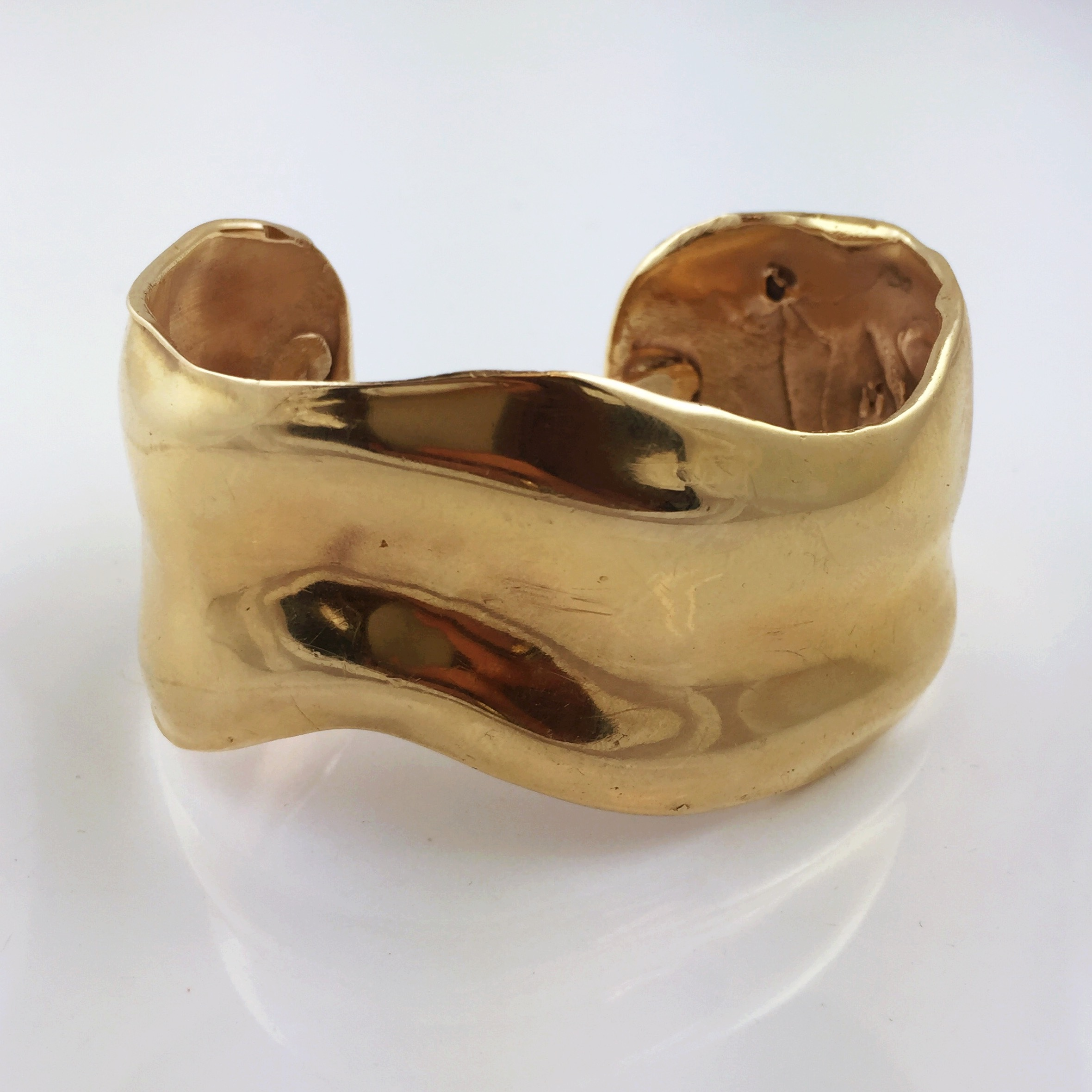 The gold cuff bracelet he made for his mother, and then gifted to his daughter on her 25th birthday.