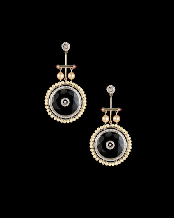 Wheels of Life earrings in onyx, diamonds and pearls.