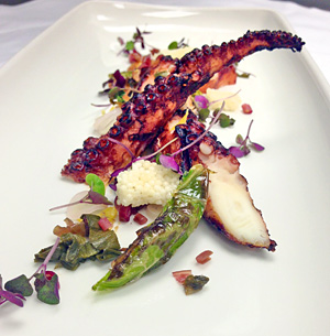 Charred octopus with shishito, pine nuts, red onion, sake and lemon.
