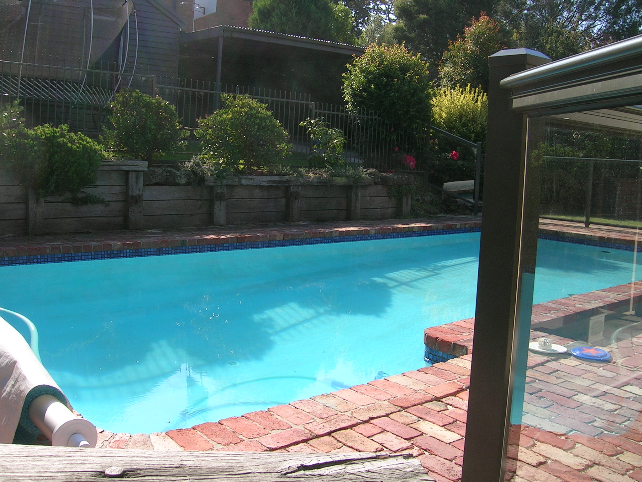 Before - a tired, shabby lookingspace, with no room to play around the pool or even outside the pool!