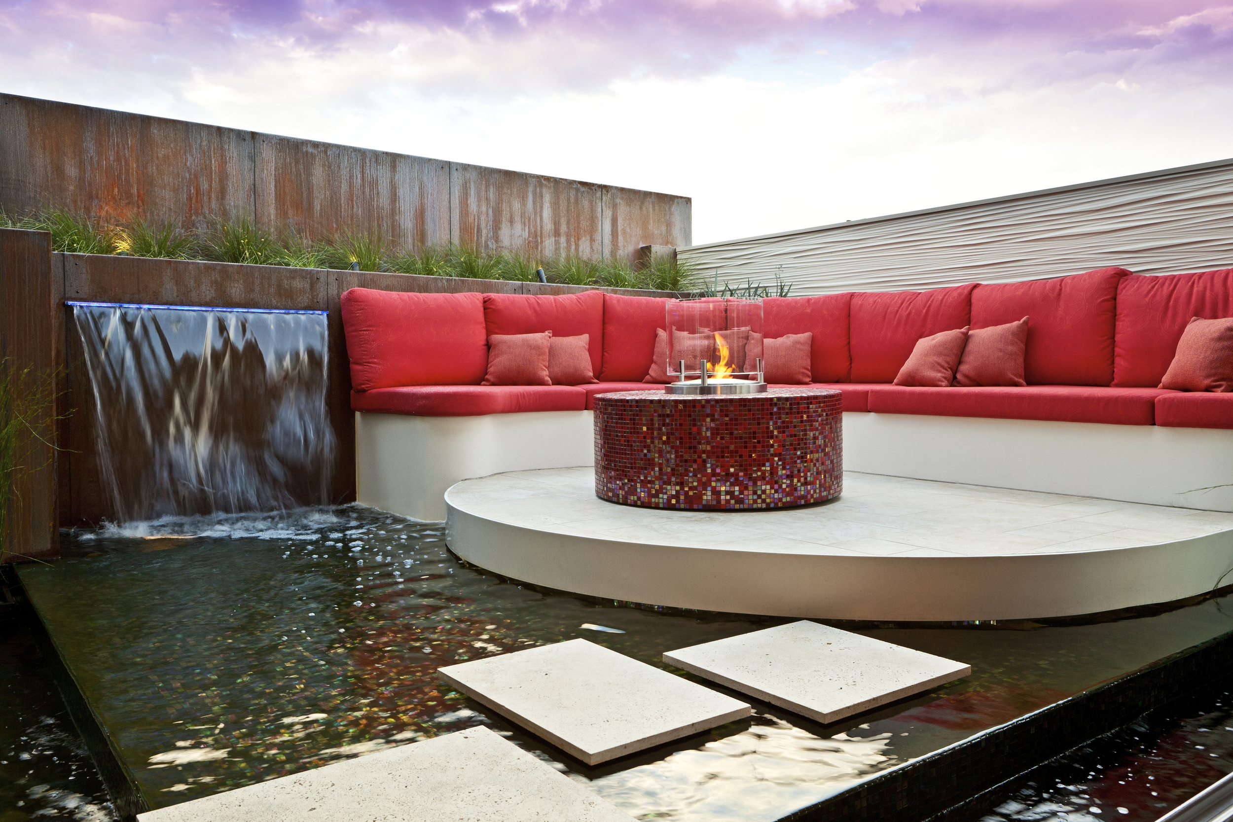 A dramatic rooftop garden space that incorporates moving water, a 'floating' outdoor lounge and observation platform, and plenty of fish.