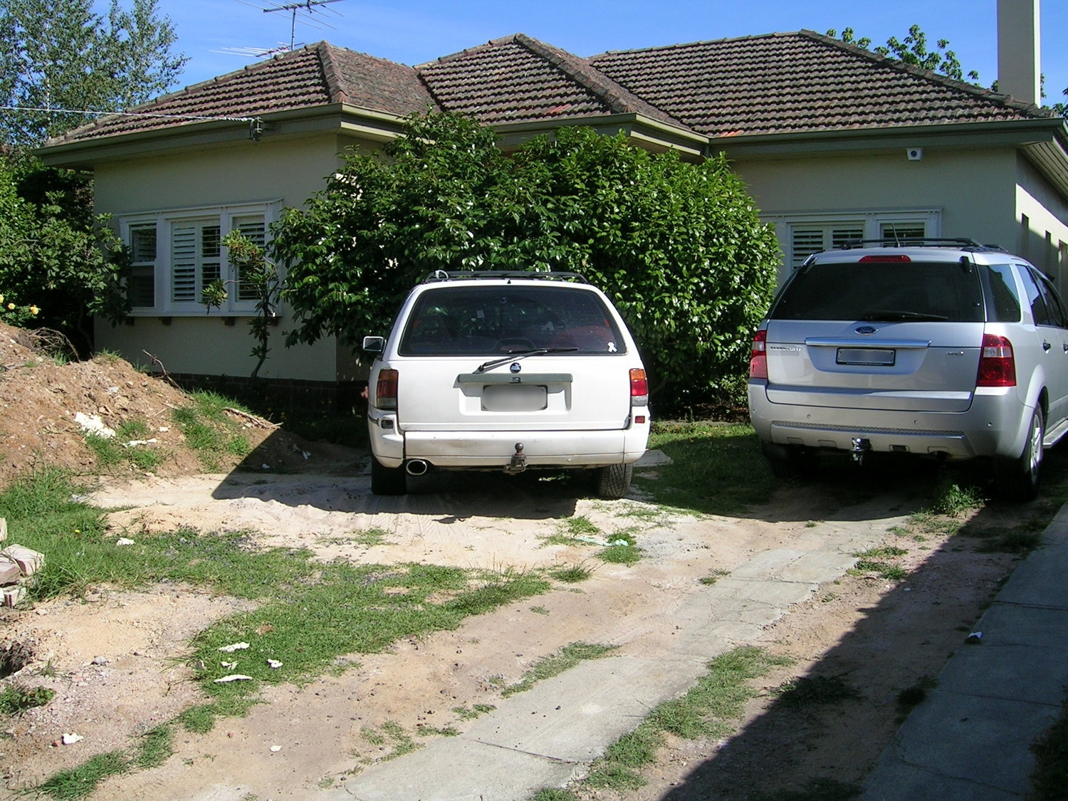 Before - an overgrown, unusable space, with loads of potential.