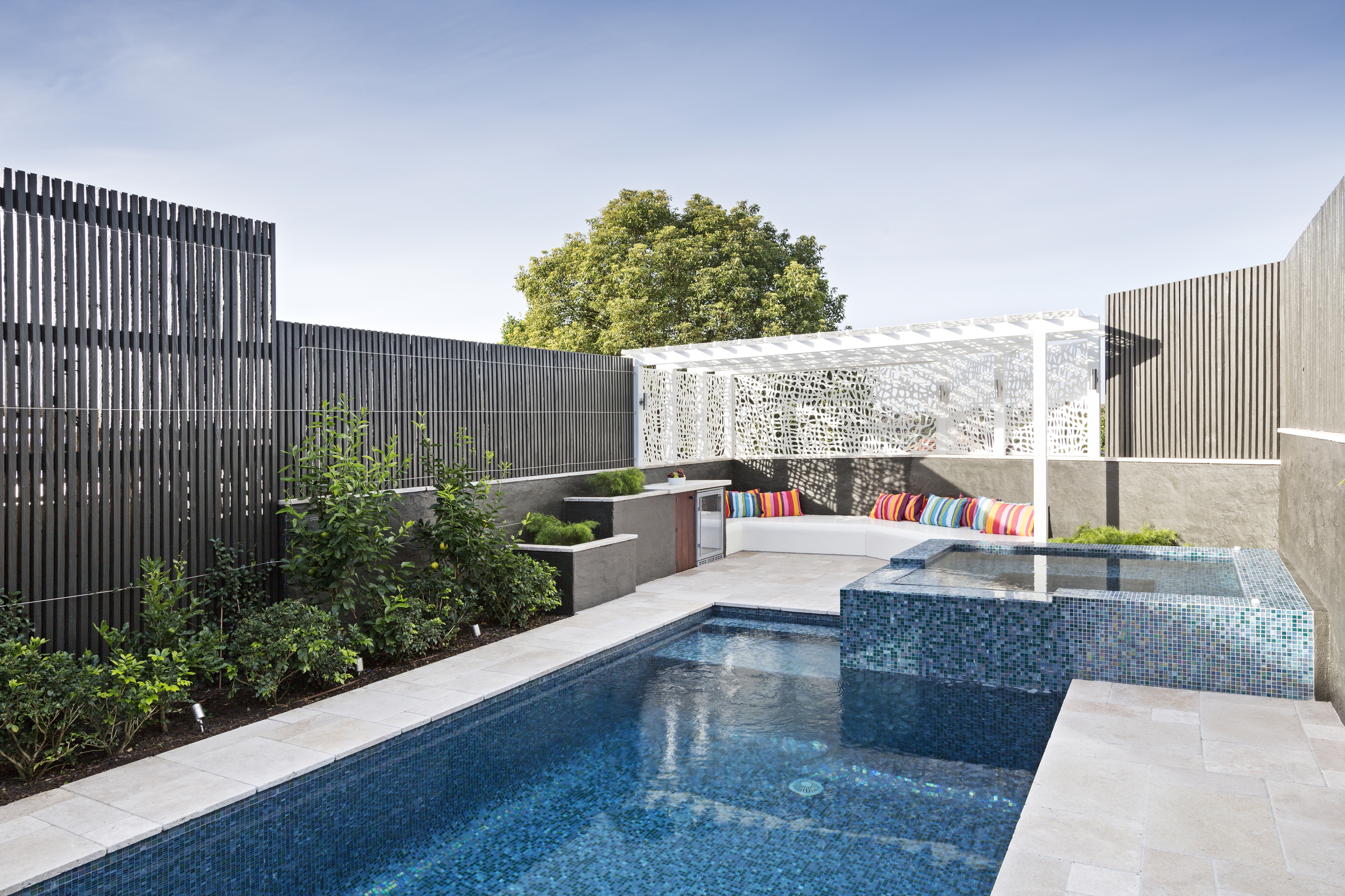 The spa keeps warm water flowing into the pool, giving it year-round use andappeal. A screen of timber battens gives privacy to the newly-elevated area from neighbours, and the powder-coasted steel arbour gives some dappled shade - its design is inspired by the water movement below.