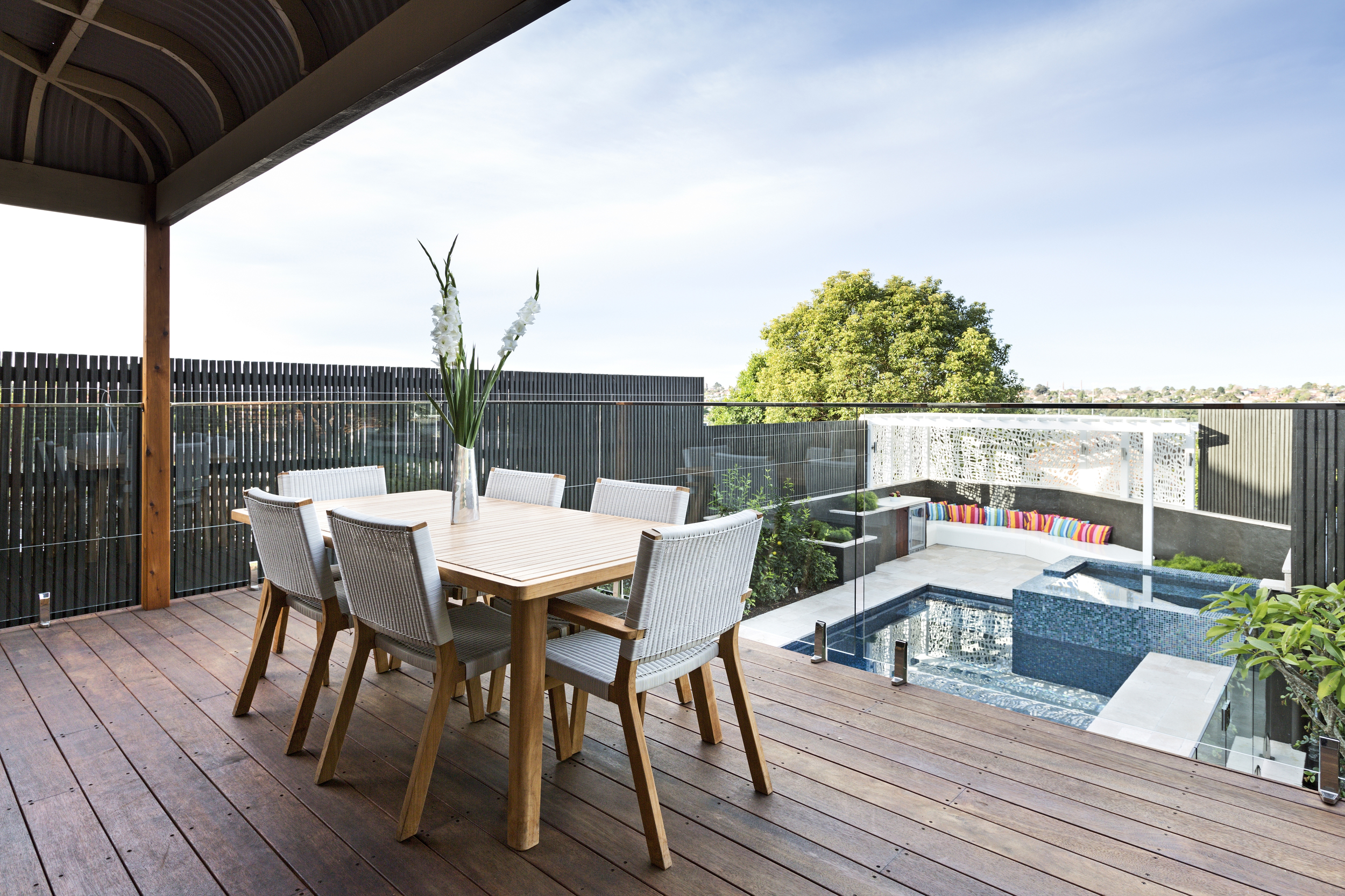 The expanded deck area gives enough dining space for the whole family, as well as housing storage, a change roomand shower underneath.