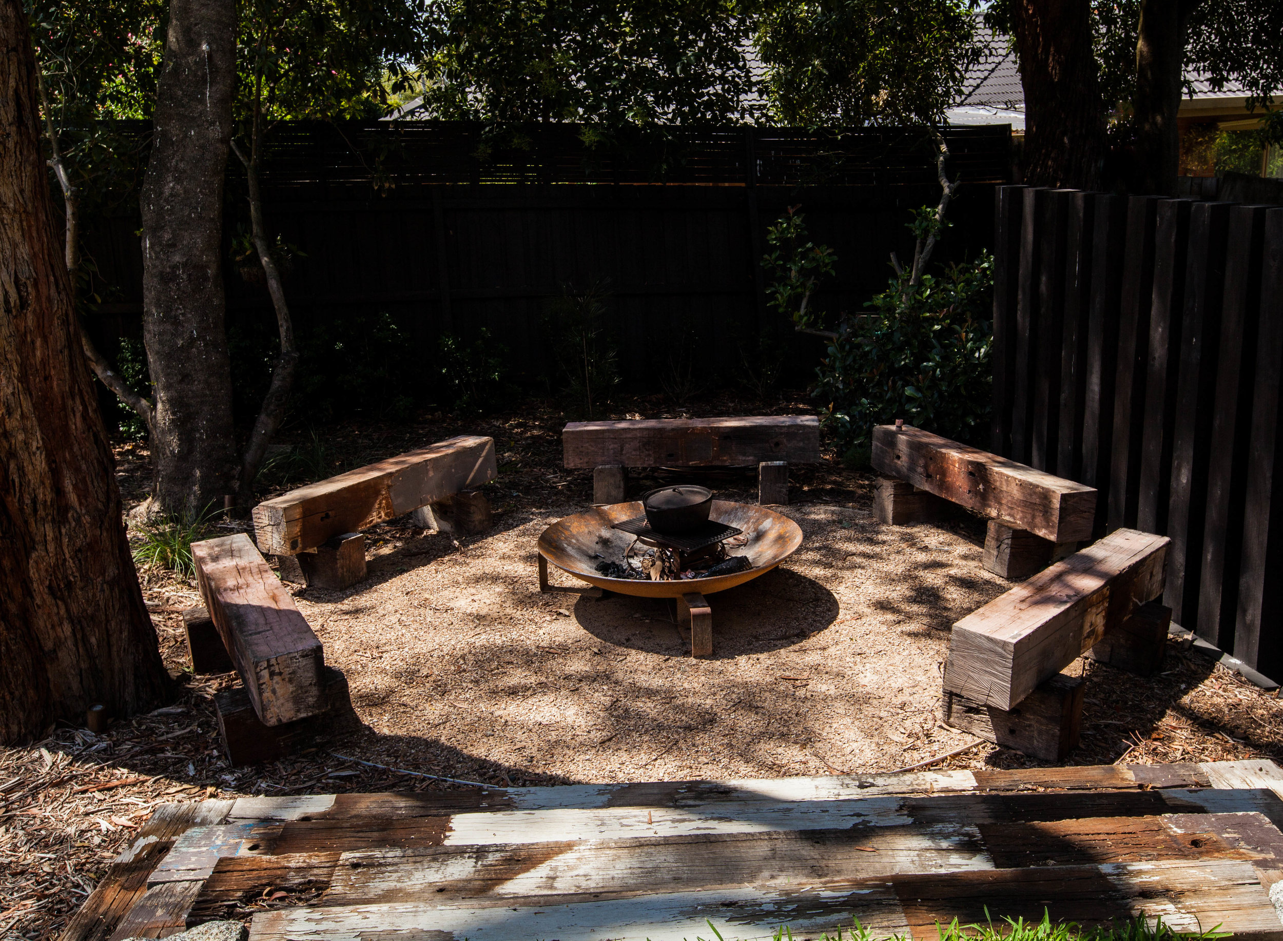 AFTER: The sunken 'campfire lounge'seating area, where smaller groups can site and chat over a crackling fire.