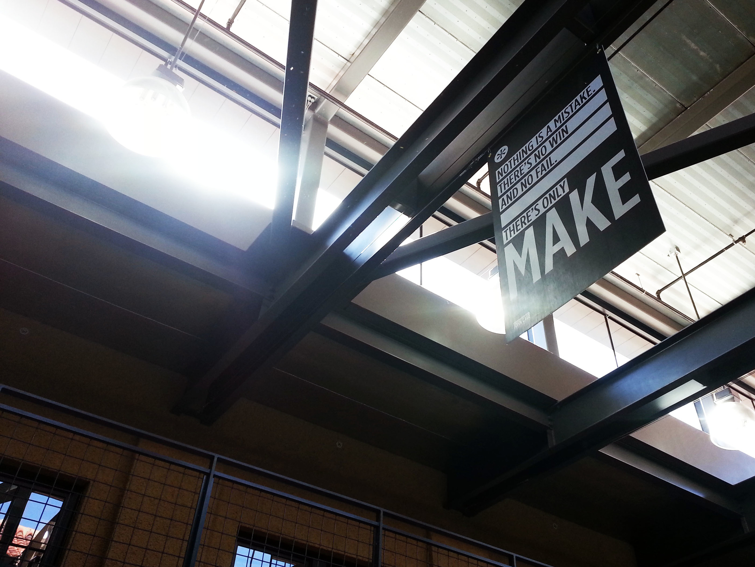 """A sign hanging in the d.school above the atrium reads, """"Nothing is a mistake. There's no win and no fail. There's only make."""" (Emi Kolawole)"""