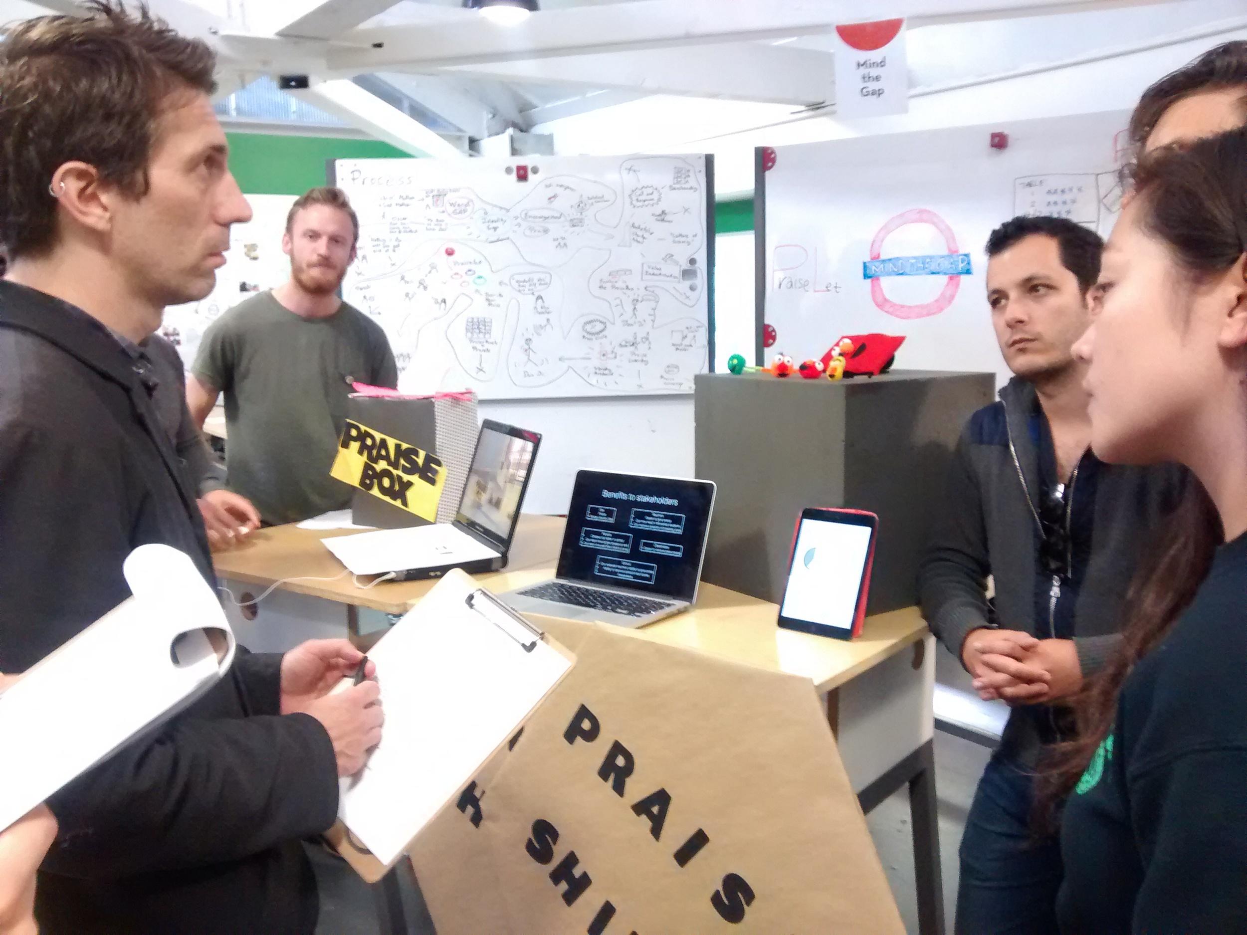 """Students present their prototype, """"Praise Sheild"""" to members of the Sesame Workshop team. (Emi Kolawole)"""