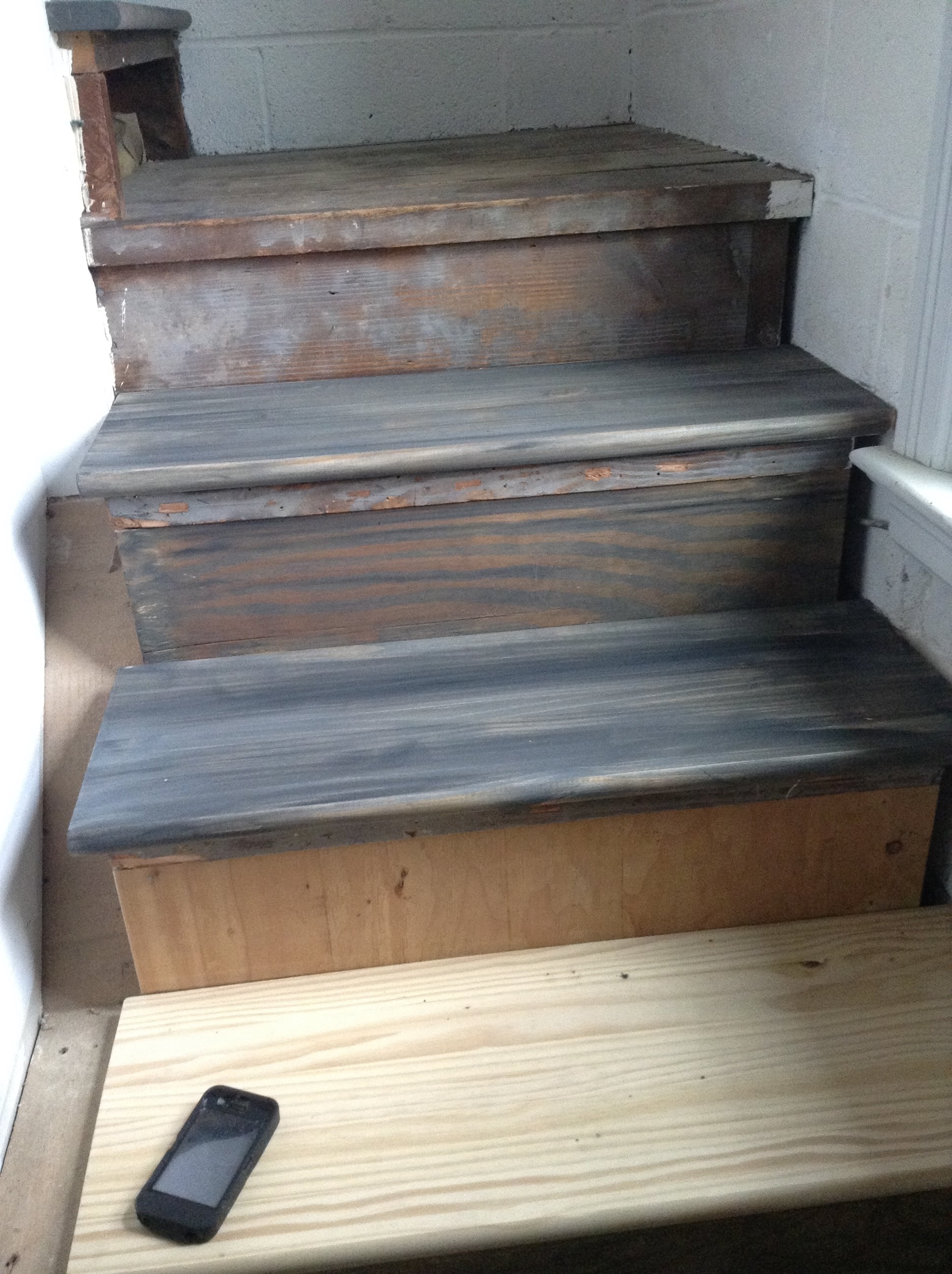 our new pine treads were aged with a gray wash to better match the existing wood that we reused