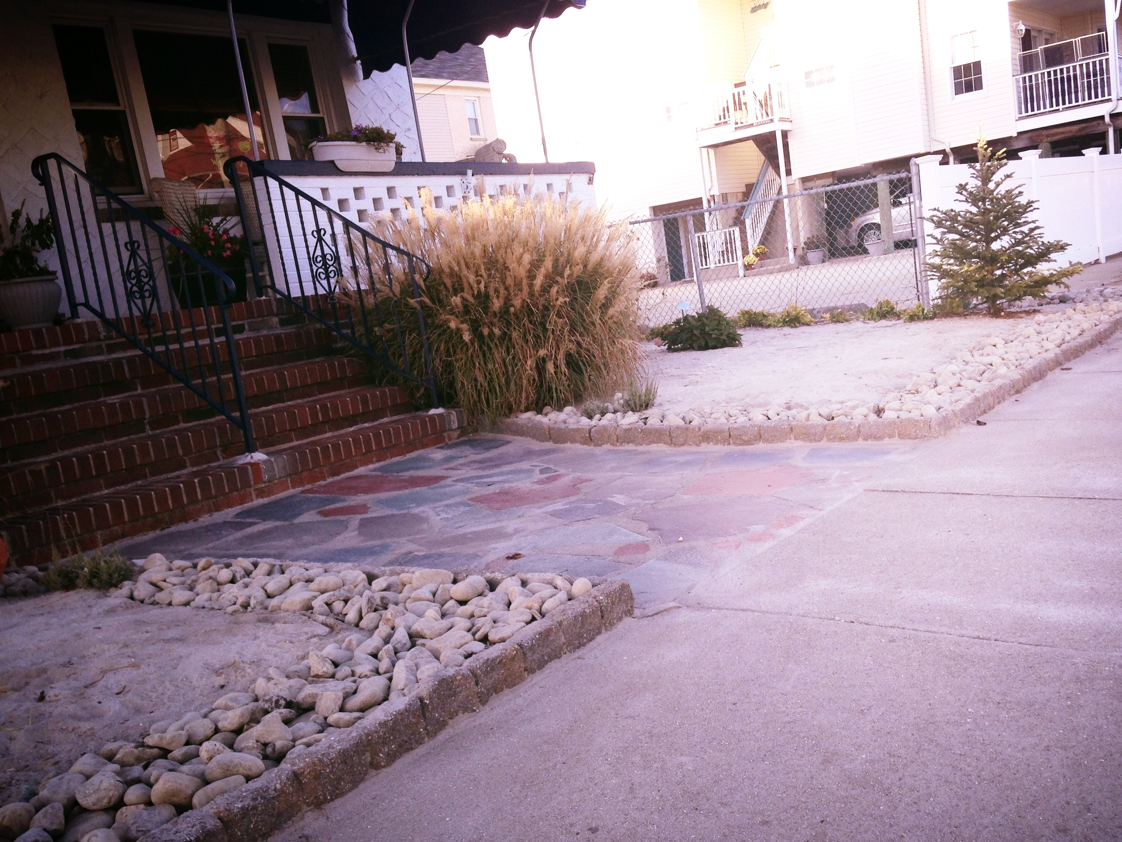 xeriscaping with sand and rock drainage system